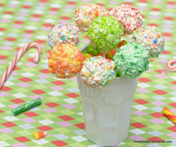 When displaying as a bouquet, prop each Fake Pop in place by filling the glass with candies (or rice), and sticking the lollipop handles inside.